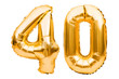 Number 40 forty made of golden inflatable balloons isolated on white. Helium balloons, gold foil numbers. Party decoration, anniversary sign for holidays, celebration, birthday, carnival