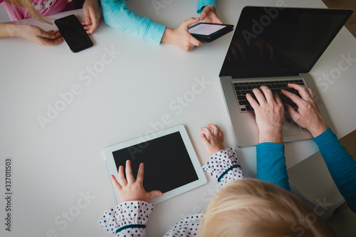 Fototapeta family on remote work and learning, father and kids using gadgets obraz