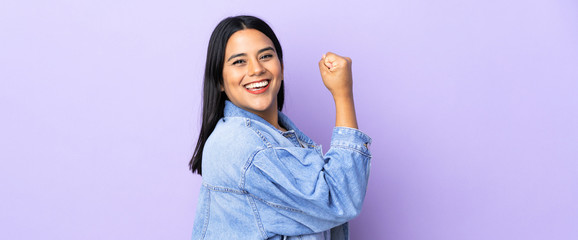 Young latin woman woman over isolated background doing strong gesture