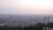 Seoul Yongsan Gu Panorama From Height Of Nam Mountain, Thick Foggy Air At Evening Time, Smog Over Asian Metropolis. Low Rise Buildings On Foreground, Dense Build Residential Area. Several Tall Towers