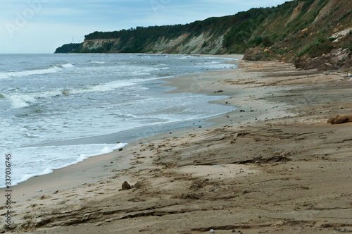 steep coast of the sea, landslides and destruction to the shores of the sea Canvas Print