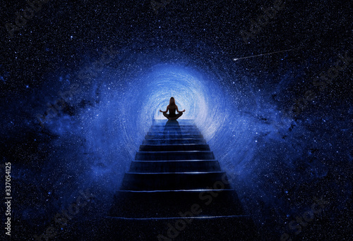 Woman in yoga pose at top of stair