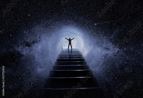 Man with posture of success on top of ladder