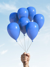 A Few Blue Balloons In The Hand