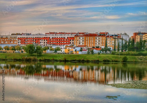 reflected city view on the river Guadiana of city Badajoz, Spain, europe
