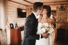 Bride And Groom Kiss At The Fi...
