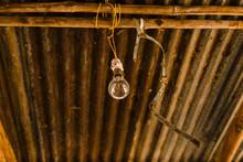 Lightbulb Hanging On Wooden Beams