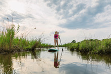 Young Girl On Stand Up Paddle ...
