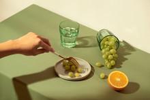 Summer Still Life: Woman Holding Green Grape