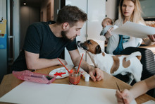 Young Family And A Dog At Home