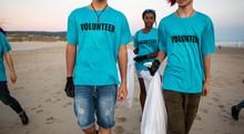 Volunteers Carrying Trash Bags