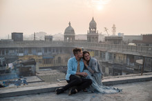 Travel Couple Watching Sun Ris...