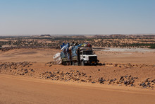 Heavily Loaded Truck Transporting Goods Parked Next To Orad In The Sahara Desert, Chad, Africa