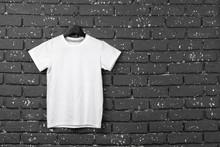 White T-shirt Hanging On Hange...