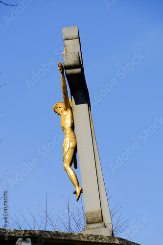 Low Angle View Of Gold Crucifix Against Clear Blue Sky Fototapete