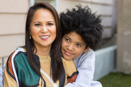 Portrait of an Asian mother with her teenage son. Wallpaper Mural