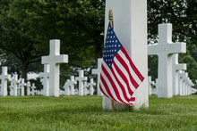 American Flag And Crossed At Cemetery