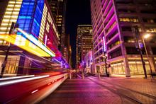 Long Exposure Shot Of A Light Rail Train Zooming Through Houston, Texas' Main Street Square.