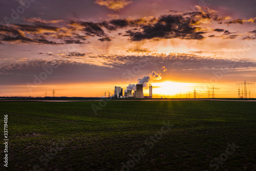 Distant View Of Factory Against Cloudy Sky During Sunset Fototapete