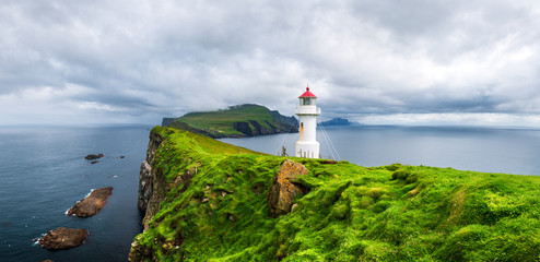 Panoramic view of old lighthouse on the Mykines island, Faroe islands, Denmark. Landscape photography