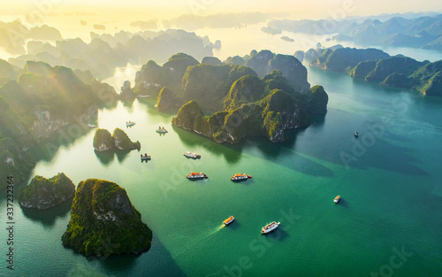 Tablou Canvas Aerial view floating fishing village and rock island, Halong Bay, Vietnam, Southeast Asia