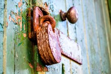 Close-up Of Padlock Hanging On Wooden Door