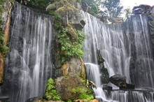 Low Angle Shot Of A Beautiful Artificial Waterfall At Longshan Temple In Taipei, Taiwan