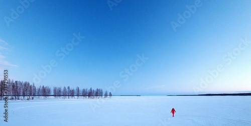Scenic View Of Snow Covered Landscape Against Blue Sky - fototapety na wymiar