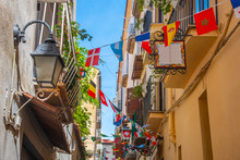 Flags In A Narrow Alley In Old...