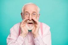 Closeup Photo Of Attractive Grandpa Screaming Empty Space Hands Near Open Mouth Secret Information Wear Specs Pink Shirt Suspenders Bow Tie Isolated Teal Color Background