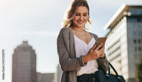 Fototapeta Real estate agent using phone while commuting