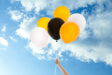 Woman With Colorful Balloons O...