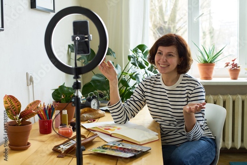 Obraz na plátne Female artist filming design workshop at home for online education