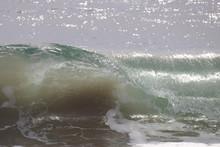 Closeup Of Curling Ocean Waves...