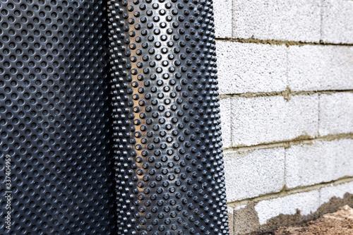 basement wall waterproofing - installing dimple geomembrane Fototapet