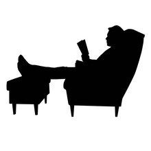 Man Sitting In Armchair With L...