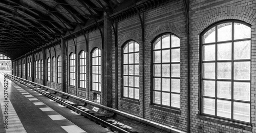 Fototapeta Railroad Track By Wall In Subway Station obraz na płótnie