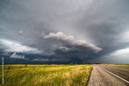 Fototapeta Scenic View Of Field Against Storm Clouds