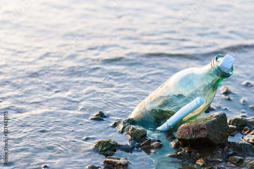 Glass bottle with a letter Fototapet