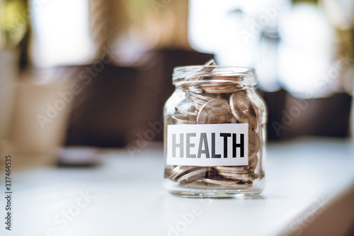 Photo Health money accumulation concept - glass jar with coins.
