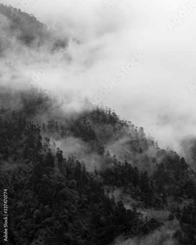 Fotografie, Obraz a beautiful mountain view with fog and clouds