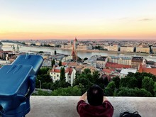 Rear View Of Man Looking At Hungarian Parliament Building Against Sky
