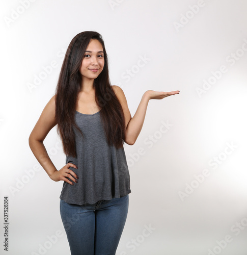 Fototapety, obrazy: Pretty Girl In Jeans Holds Her Hand Out