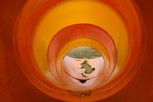 Close-up Of Abandoned Orange Slide At Playground
