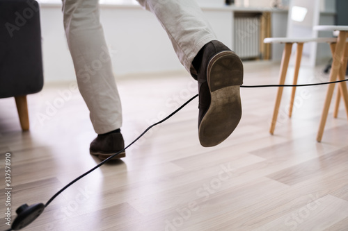 Obraz Man Legs Stumbling With An Electrical Cord - fototapety do salonu