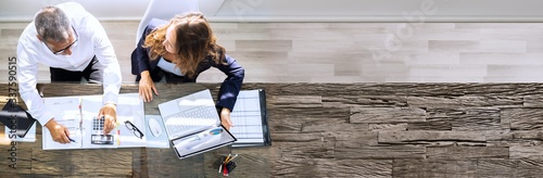 Businesspeople Using Laptop In Office Wallpaper Mural
