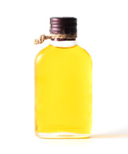 Yellow Oil In A Glass Bottle Isolated On A White