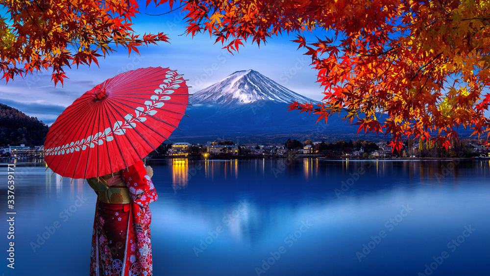 Fototapeta Asian woman wearing japanese traditional kimono at Fuji mountain. Autumn at Kawaguchiko lake in Japan.
