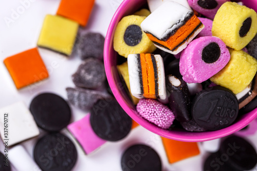 Liquorice allsorts fondant and licorice sweets or candy studio isolated Canvas Print