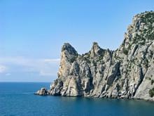 Southeast Crimea, The Karaul-Oba Mountain Range Protrudes Far Into The Blue Sea, Against The Background Of The Azure Sky